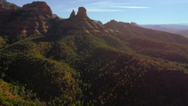 remote scenic aerial view on the mountains in slide rock state park in sedona arizona, from the scenic route 89a. drone video with the panoramic-descending camera motion. - sedona stock videos & royalty-free footage