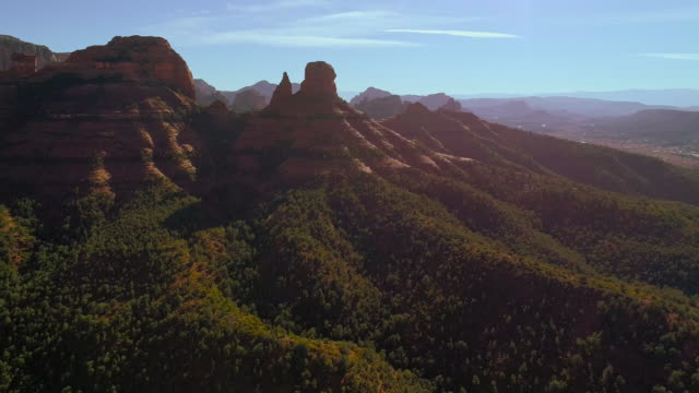 remote scenic aerial view on the mountains in slide rock state park in sedona arizona, from the scenic route 89a. drone video with the backward-panoramic complex camera motion. - sedona stock videos & royalty-free footage