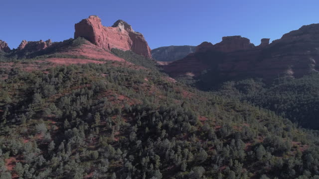 remote scenic aerial view on the mountains in slide rock state park in sedona arizona, from the scenic route 89a. drone video with the forward and ascending camera motion. - sedona stock videos & royalty-free footage