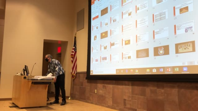 remote students are shown on a screen behind unlv department of criminal justice chairman and professor dr. joel lieberman as he teaches jury... - teaching stock videos & royalty-free footage
