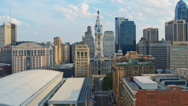 remote view of the philadelphia city hall along with broad street. drone video with the backward camera motion. - william penn stock videos & royalty-free footage