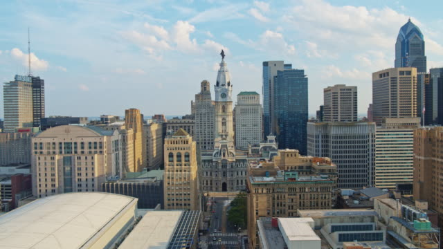 remote view of the philadelphia city hall along with broad street. drone video with the forward camera motion. - william penn stock videos & royalty-free footage
