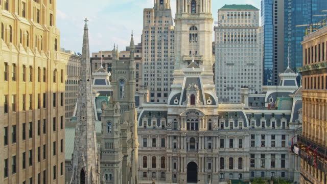remote view of the philadelphia city hall along with broad street. drone video with the ascending camera motion. - william penn stock videos & royalty-free footage
