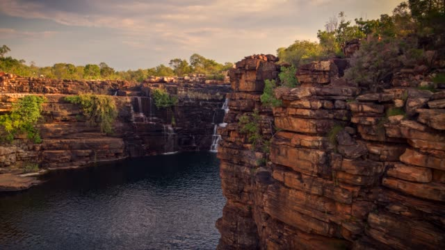 remote waterfall in the kimberley, western australia - outback stock videos & royalty-free footage