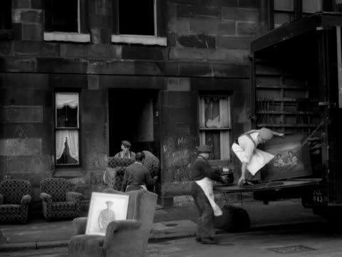 removal men load furniture into the back of a removal van. - 1950 1959 stock videos & royalty-free footage
