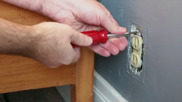 removing an electrcial outlet - plug socket stock videos & royalty-free footage