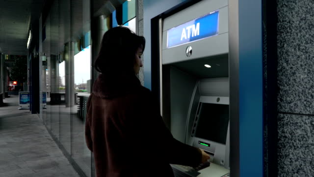 atm removing card and money - absence stock videos & royalty-free footage