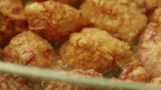 removing chicken pieces from oil - stationary process plate stock videos & royalty-free footage