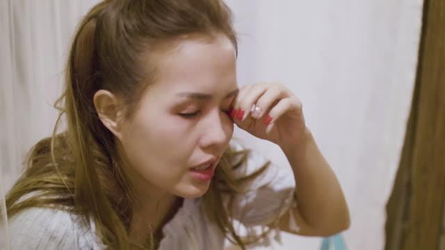 4k : removing make-up eyelash - eyelash stock videos & royalty-free footage