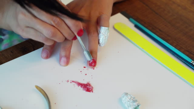 removing nail polish from hand fingers, damaging nails - beauty spa stock videos & royalty-free footage