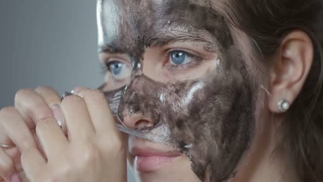 Removing peel off mask from face