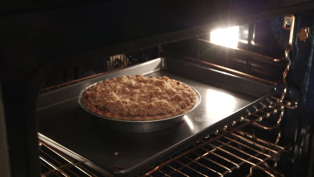 cu removing pie from oven 2 - wiese stock videos & royalty-free footage