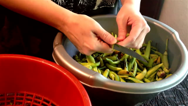 removing stems from chili peppers - raw food diet stock videos & royalty-free footage