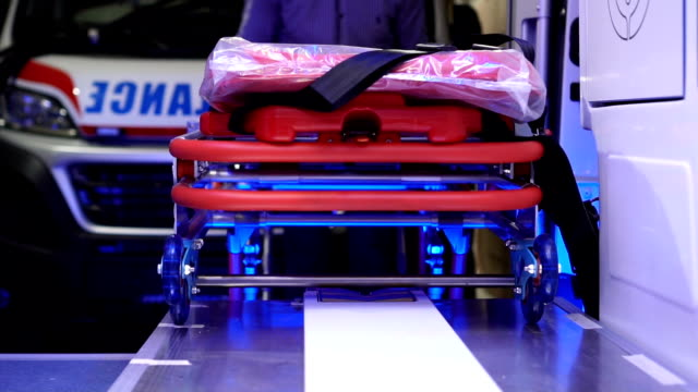 removing stretchers from vehicles- slow mo - stretcher stock videos & royalty-free footage