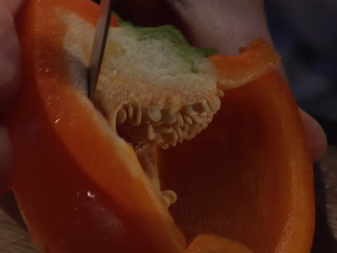 removing the stem and seeds from a red bell pepper - unknown gender stock videos & royalty-free footage