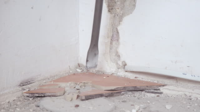 Removing tiles with jackhammer