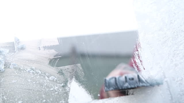 removing windshield ice with a scrapper and a brush. - windscreen stock videos & royalty-free footage