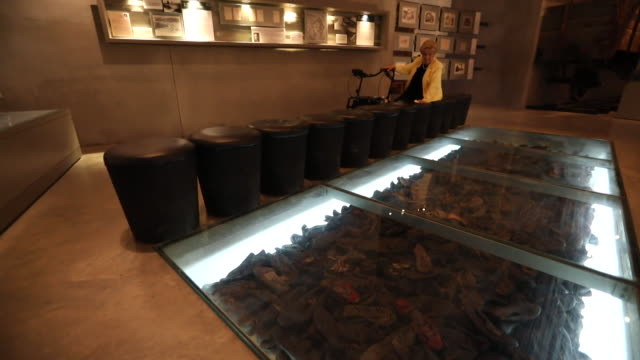 "rena quint holocaust survivor looks at show exhibit at the yad vashem world holocaust remembrance centre - ""bbc news"" stock-videos und b-roll-filmmaterial"