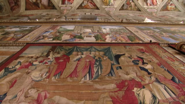 renaissance artist raphael's tapestries hung below michaelangelo's painted ceiling in the sistine chapel vatican - renaissance stock-videos und b-roll-filmmaterial