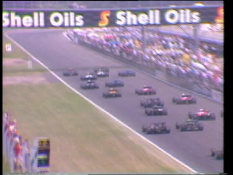 renault racing; itn tx 16.7.83 england: silverstone silverstone grand prix: tbv start of the grand prix cars along track r-l racing car along l-r - grand prix motor racing stock videos & royalty-free footage