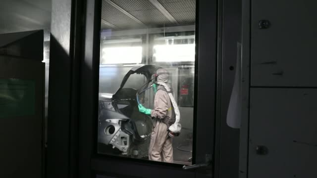 renault sa factory 3 employees carry out final inspections on the body shells of freshly painted nissan micra, right, and renault clio, second left,... - freshly painted stock videos & royalty-free footage