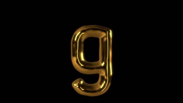 vídeos de stock e filmes b-roll de 3d rendered moving golden character type element with alpha matte - capital letter