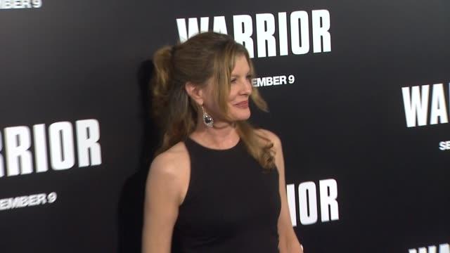 rene russo at the 'warrior' los angeles premiere at hollywood ca. - レネ・ルッソ点の映像素材/bロール