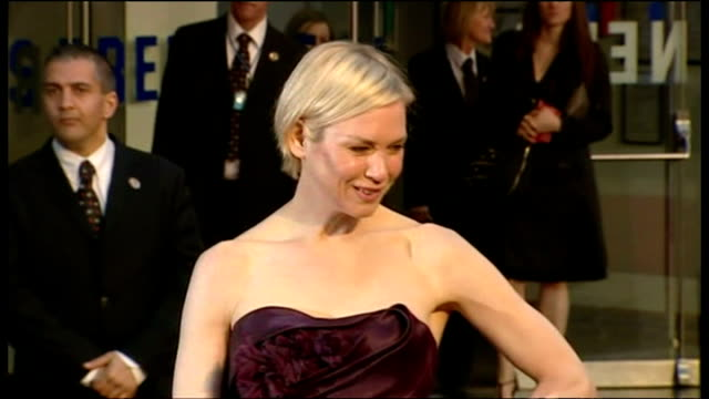 renee zellweger attends premiere of leatherheads shows exterior shots renee zellweger posing on red carpet for photographers on april 08 2008 in... - renée zellweger stock videos and b-roll footage