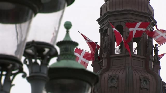 David Cameron visit to Poland and Denmark / Martin Schulz comments DENMARK Copenhagen EXT Danish flags flying from tower Exterior windows of Danish...