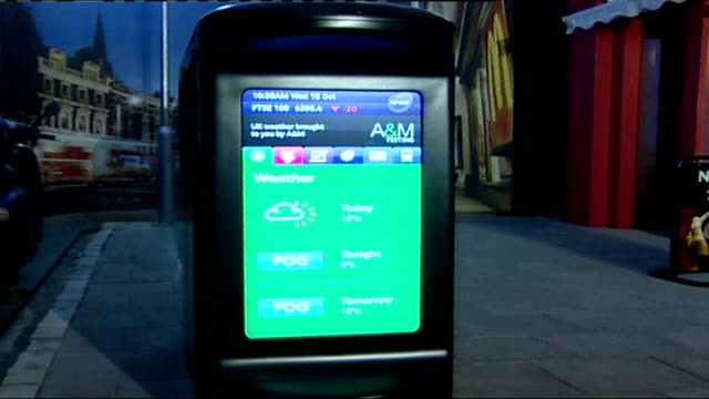 'renew' bombproof bin to be used in london streets ext 'renew' bins in street with information screens on exterior as rubbish dropped in close shot... - テレビ番組点の映像素材/bロール