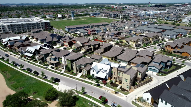 renewable and sustainable neighborhood aerial drone view above east austin , texas , usa high above solar panel suburb community - east stock videos & royalty-free footage