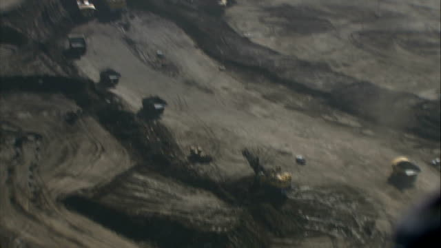 shell withdraws from london array wind farm project; r22050712 canada: alberta: int helicopter air views of tar sand mines at athabasca oil sands - alberta stock videos & royalty-free footage