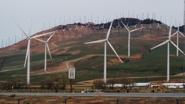 renewable energy wind turbines generating power - speed limit sign stock videos & royalty-free footage