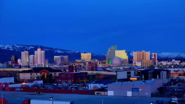 reno night to day 4k time lapse, nv - nevada stock videos & royalty-free footage