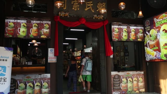 a renovated shophouse stands in the chinatown area of malacca city malaysia on wednesday july 26 a tourist enters a shophouse store on jonker street... - portionspåse bildbanksvideor och videomaterial från bakom kulisserna