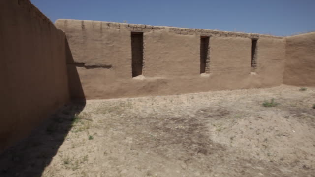 renovated walls of the ancient city of nisa, not far from ashgabat, turkmenistan - adobe material stock videos and b-roll footage