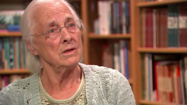 renovation of cottage of william blake runs into trouble location unknown beryl kingston taking book about blake from shelf in library and talking to... - durchpausen stock-videos und b-roll-filmmaterial