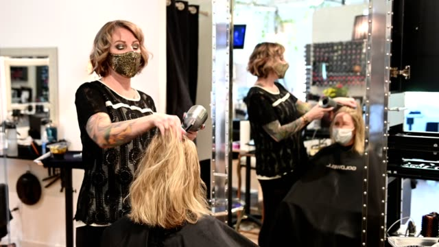reopening a beauty salon with coronavirus safety measures - reopening stock videos & royalty-free footage