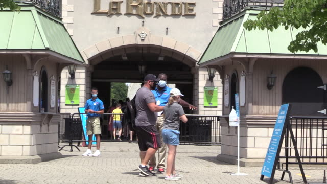 reopening six flags during pandemic. karina thevenin - laronde, communications manager, discusses the opening of six flags laronde with new safety... - montréal stock videos & royalty-free footage
