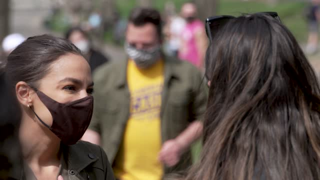 """rep. alexandria ocasio-cortez hosts and greets supporters of the """"green new deal"""" on earth day in astoria park on april 24, 2021 in the borough of... - oil industry stock videos & royalty-free footage"""