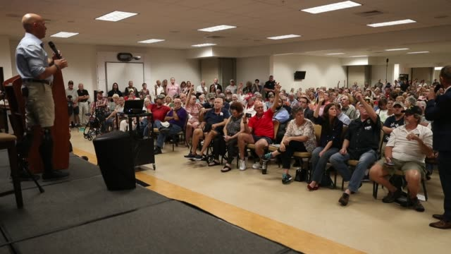 rep brian mast speaks during a town hall meeting at the havert l fenn center rep mast held the veteran's town hall meeting that ranged from topics on... - town hall stock videos & royalty-free footage