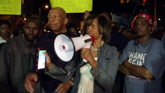 US Rep Elijah Cummings and Maryland State Senate Majority Leader Catherine Pugh urge people to be off the street as a citywide curfew takes place at...