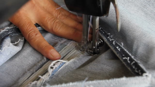 repair denim with sewing machines. - thread sewing item stock videos & royalty-free footage