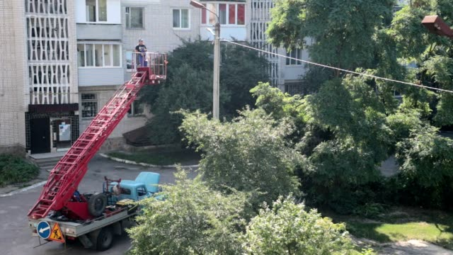 repair of street lighting. - bucket stock videos & royalty-free footage