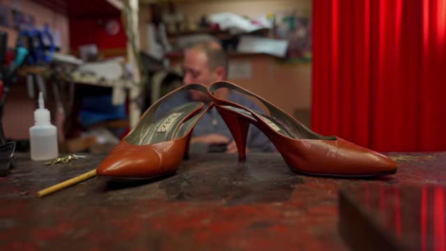 vídeos de stock e filmes b-roll de repaired brown leather shoes with heels - produto artesanal