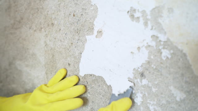 repairing a damaged concrete wall. - wall building feature stock videos & royalty-free footage