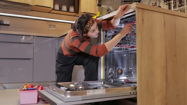repairing a dishwasher - genderblend stock videos & royalty-free footage