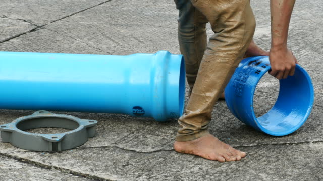 repairing big underground water pipe - weathered stock videos & royalty-free footage