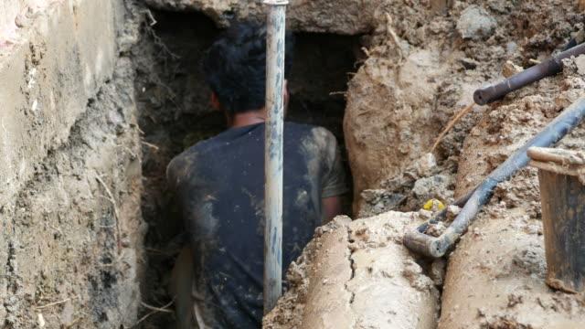 repairing big underground water pipe
