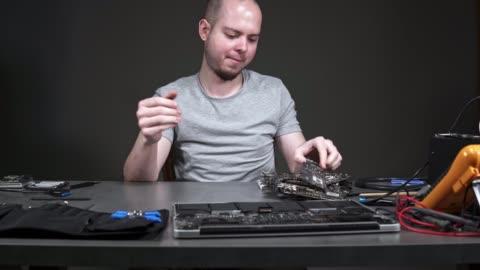repairing circuit board in his workshop - completely bald stock videos & royalty-free footage